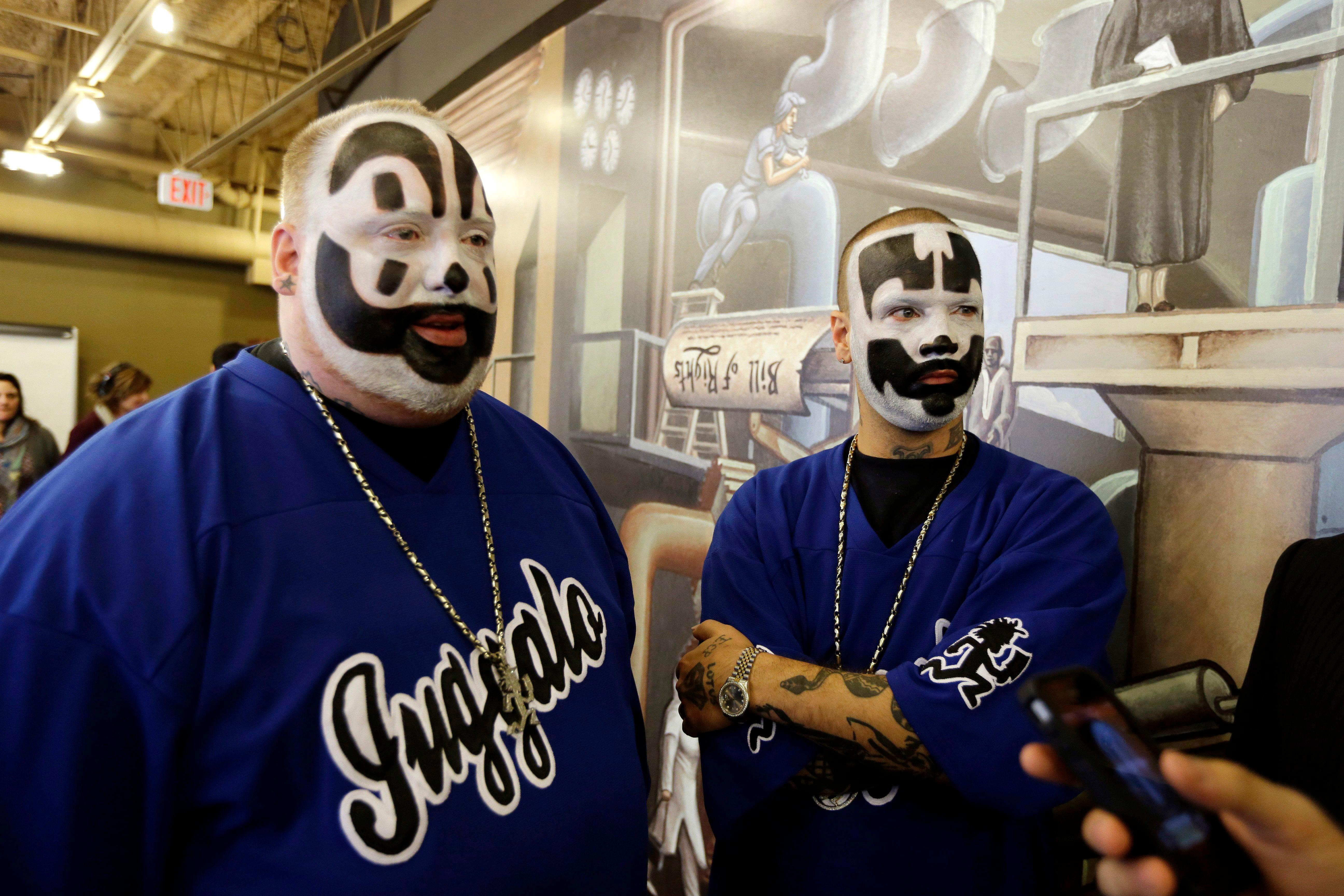 FILE - This Jan. 8, 2014, file photo shows Joseph Bruce aka Violent J, left, and Joseph Utsler aka Shaggy 2 Dope, members of the Insane Clown Posse after a news conference in Detroit. Stanley Gebhardt, of Ohio, filed a copyright infringement suit Tuesday, March 28, 2017, in federal court in Detroit saying the rap-metal group and member Joseph Bruce used a poem he wrote without his consent. (AP Photo/Carlos Osorio, File)