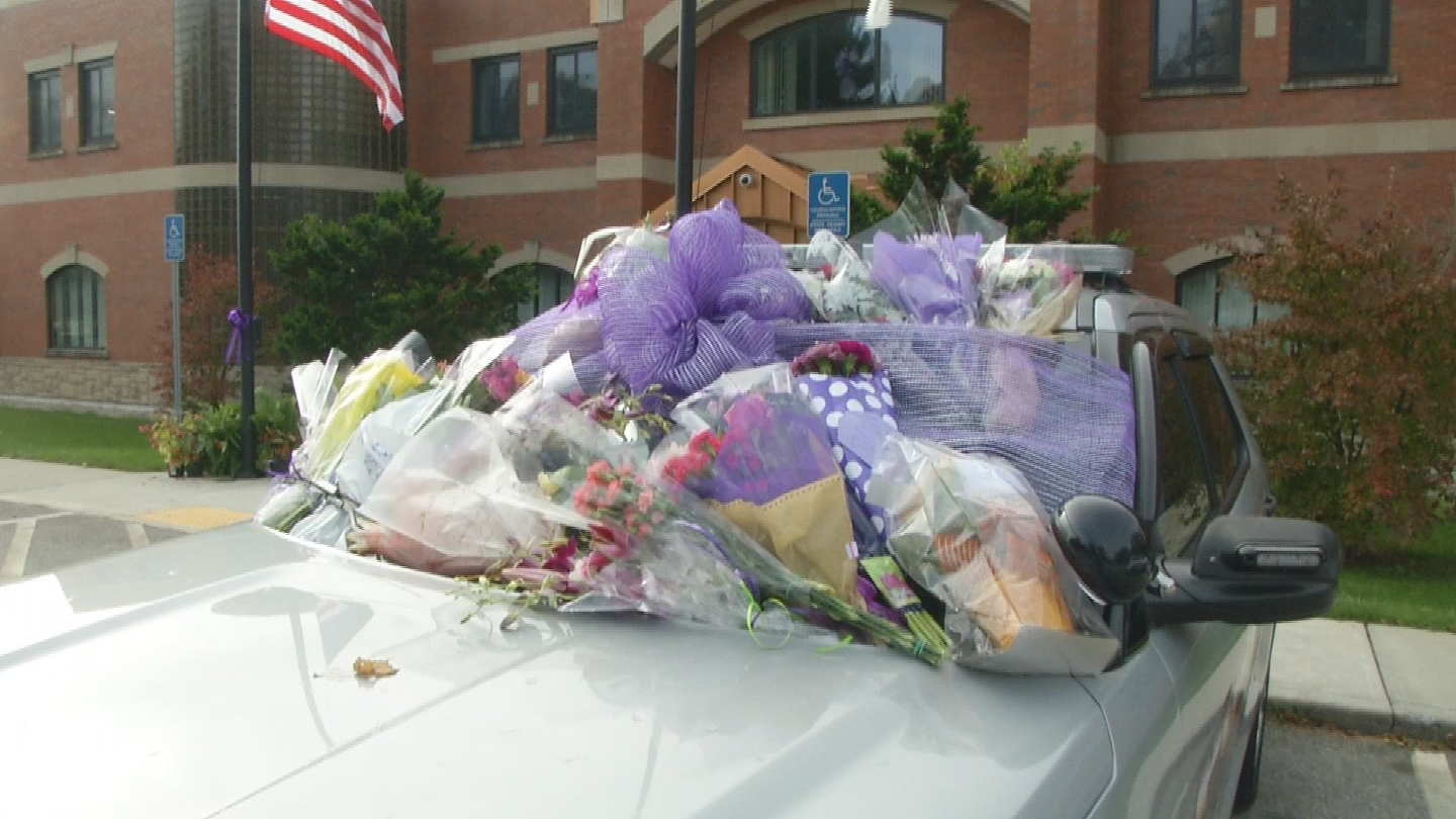 Purple decorations are placed on an East Greenwich police cruiser. (WJAR)
