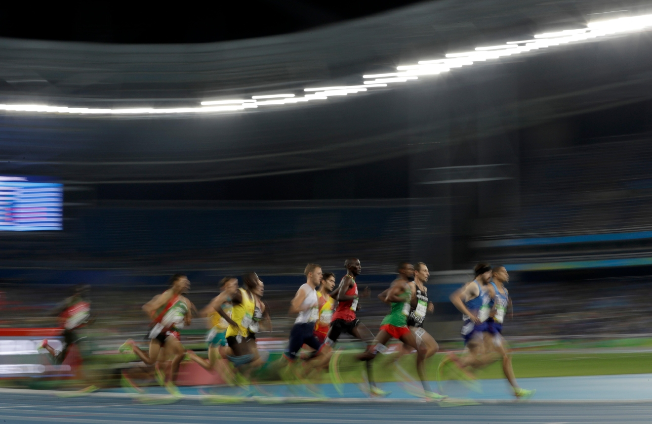 United States' Matthew Centrowitz, right, leads in the men's 1500-meter final during the athletics competitions of the 2016 Summer Olympics at the Olympic stadium in Rio de Janeiro, Brazil, Saturday, Aug. 20, 2016. (AP Photo/David J. Phillip)
