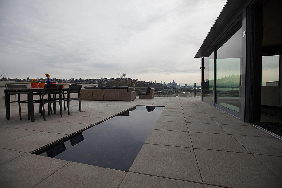 This 3 bedroom 2.5 bathroom penthouse condominium in Magnolia was originally built in 2013, and sits atop a 17 unit apartment complex. It's a single level dwelling that wraps around three side of a courtyard, and boasts views of Interbay, Mt. Rainier, and Elliott Bay. Architecture was done by