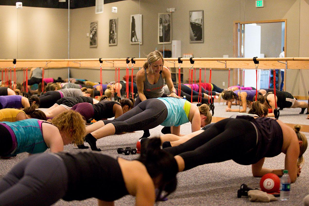 Instructors individually help members during Barre class to prevent injuries. (Image: Joshua Lewis)