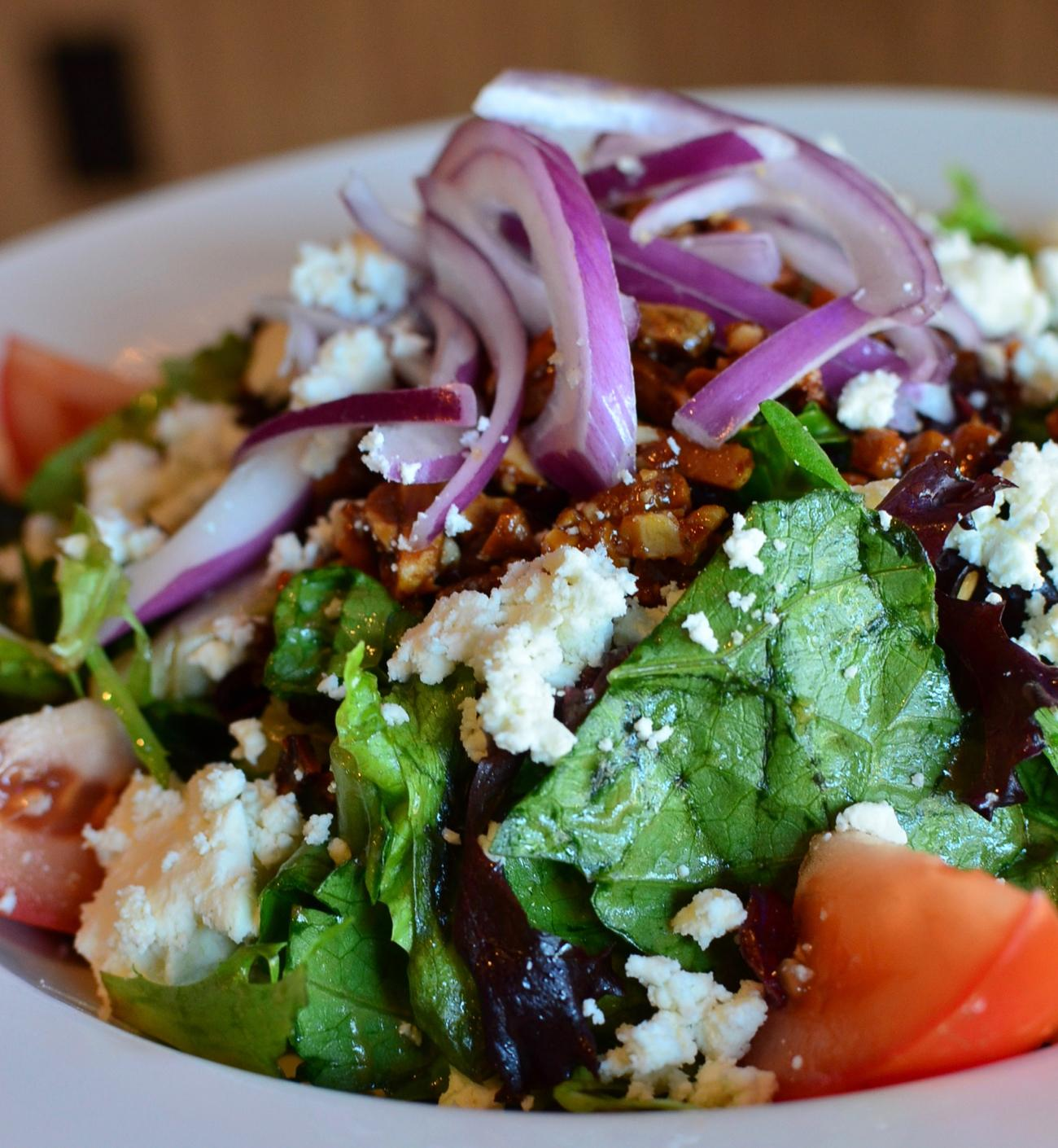 L.L. Salad: crisp salad mix tossed in balsamic vinaigrette, topped with feta cheese, craisins, candied almonds, tomatoes, red onion & served with a garlic roll / Image: Leah Zipperstein, Cincinnati Refined / Published: 1.5.16