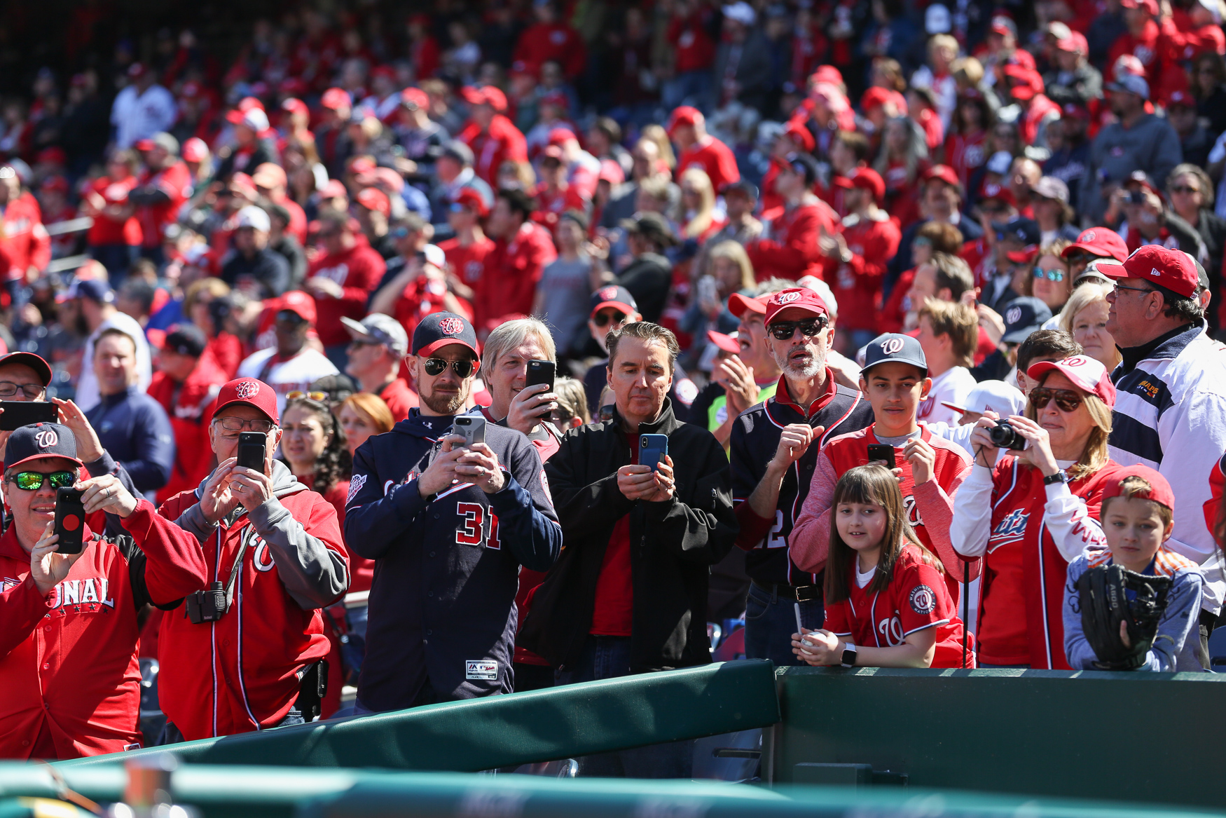 The Washington Nationals are taking on the New York Mets at home for the opening day of the 2019 baseball season. The Nationals acquired several new players this year, but the stars that stayed on got an especially warm reception from the crowd. The game started with a ceremonial opening pitch from{ }