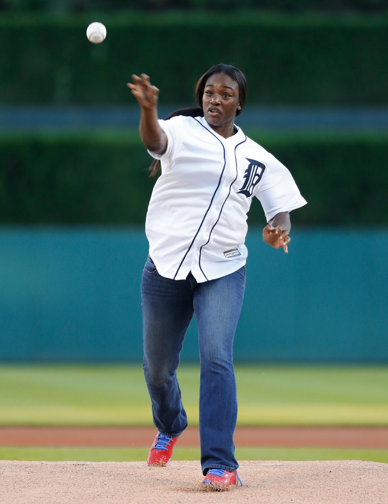 Olympic gold medalist boxer Claressa Shields throws a ceremonial pitch before a baseball game between the Detroit Tigers and Minnesota Twins in Detroit, Monday, Sept. 12, 2016. (AP Photo/Paul Sancya)