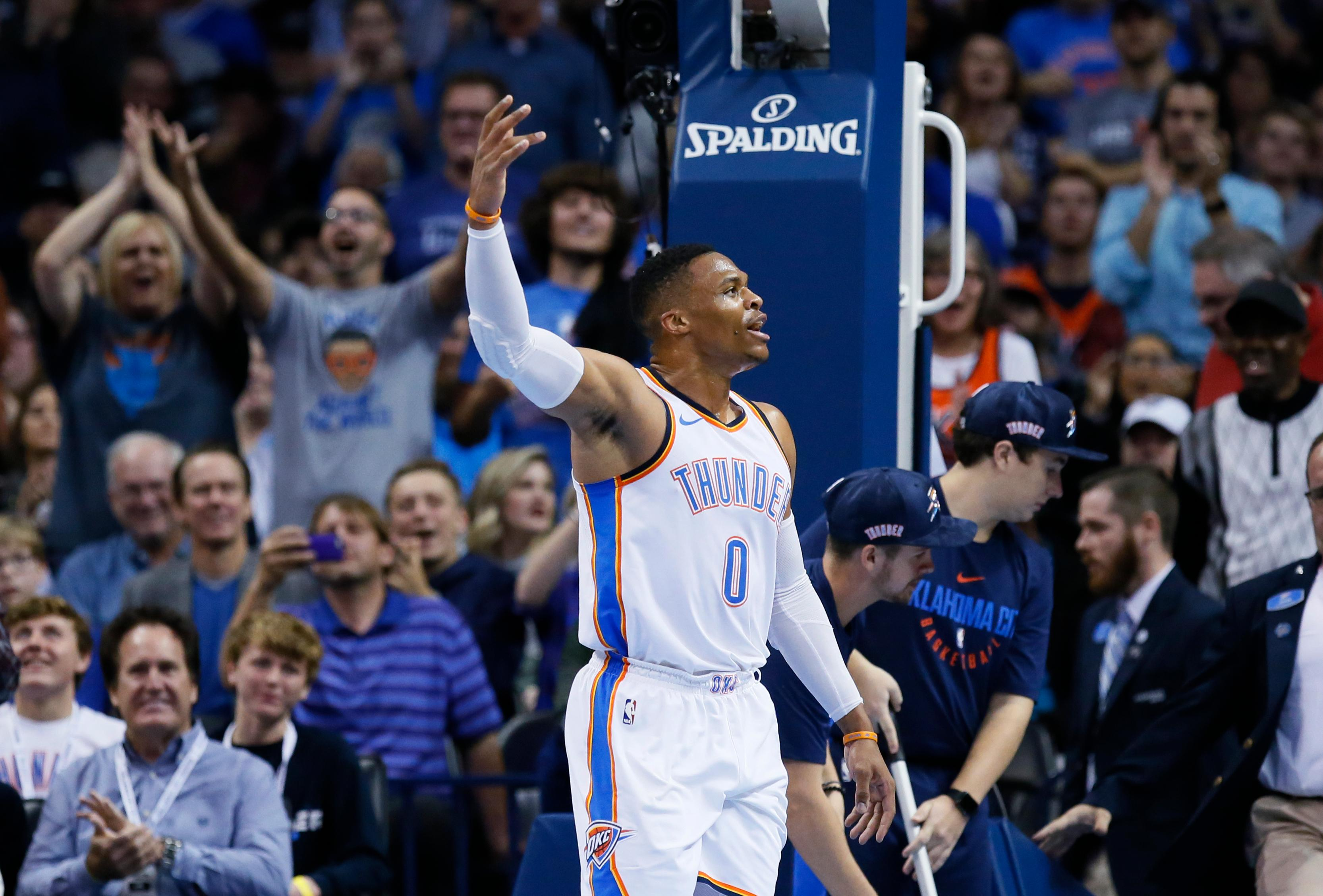 Oklahoma City Thunder guard Russell Westbrook (0) gestures to the crowd after scoring a basket in the first half of an NBA basketball game against the Los Angeles Clippers in Oklahoma City, Friday, Nov. 10, 2017. (AP Photo/Sue Ogrocki)