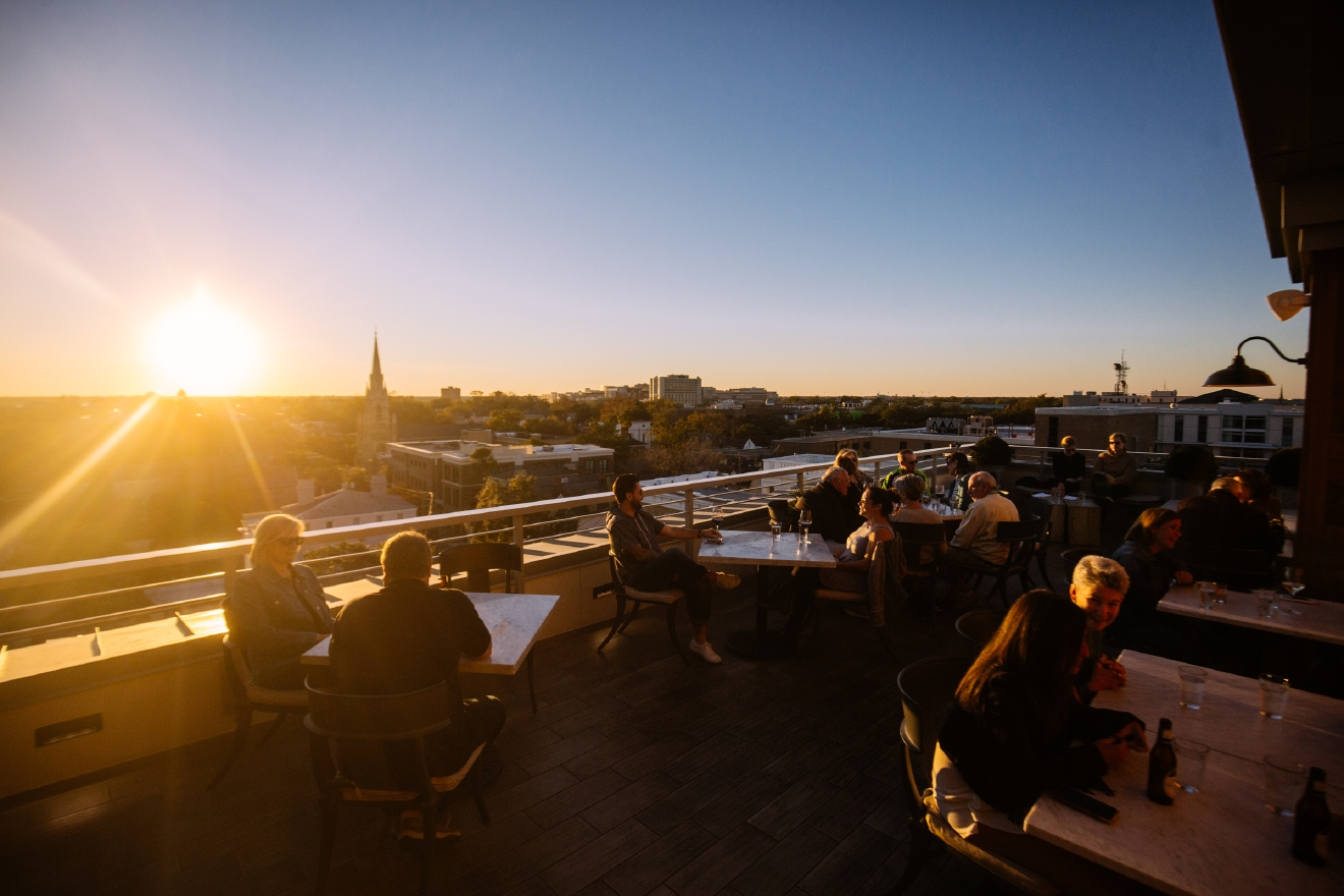 "The Watch: Rooftop Kitchen and Spirits  ""Travel and Leisure"" named Charleston, SC as the Most Romantic City in the United States and after traveling there we'd have to agree. From romantic carriage rides to rooftop bars and beautiful Magnolia Plantation and Gardens we found our 5 Most Romantic Spots in the most Romantic City. (Image: Joshua Lewis / Seattle Refined)"