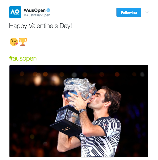 Roger Federer kisses the Australian open trophy after winning the 2017 AO title and his 18th Grand Slam.