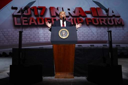 DAY 99 - In this Friday, April 28, 2017, photo, President Donald Trump speaks at the National Rifle Association Leadership Conference in Atlanta. (AP Photo/Evan Vucci, File)