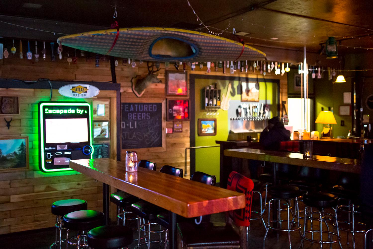 "The Camp Bar, opened by  Patrick Haight in August 2017, has a fun, tongue-in-cheek approach to the classic PNW vibe. The bar's slogan is ""where adults go to camp,"" and with deer heads hanging on the wall, tabletop s'mores, folding camping chairs, and the classic buck hunter arcade game to play, it sure feels like it. If you are passing through Tacoma, don't miss this place! Located at 1310 Tacoma Ave S. (Sy Bean / Seattle Refined)"
