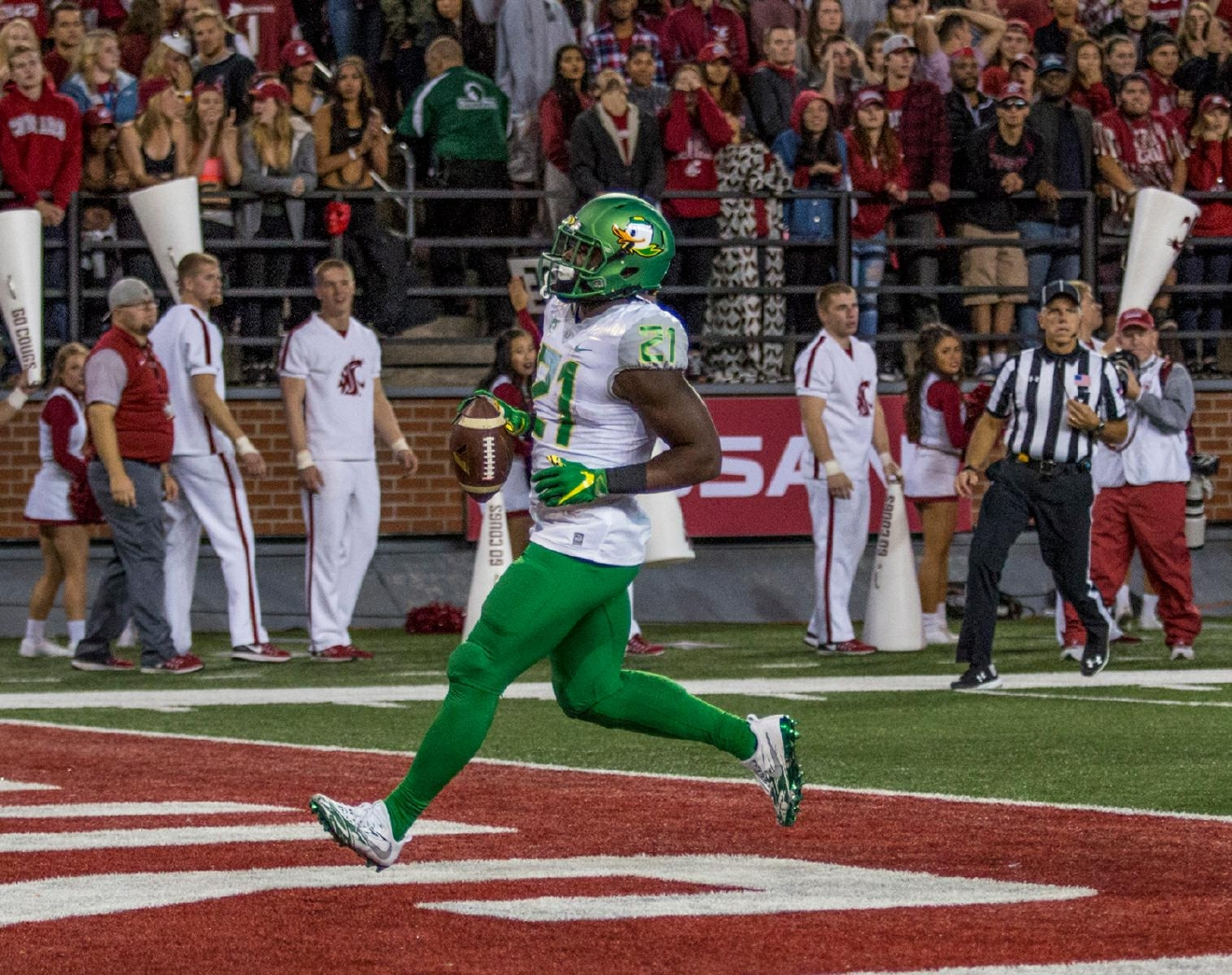 Oregon Ducks Royce Freeman (#21) rushes the ball into the endzone for the first Oregon touchdown of the game. The Washington State Cougars beat the Oregon Ducks 51-33 at Martin Stadium on Saturday evening. Photo by Katie Pietzold
