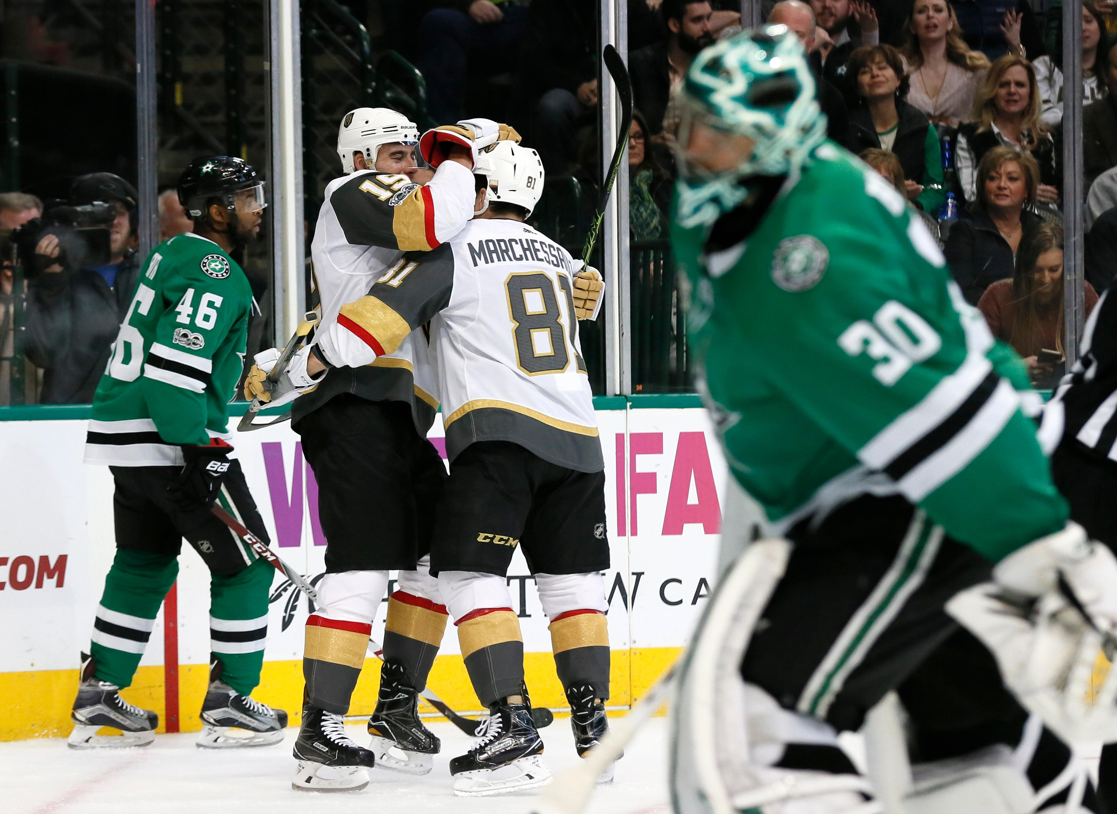 Dallas Stars' Gemel Smith (46) and goalie Ben Bishop (30) skate away as Vegas Golden Knights' Reilly Smith (19) and Jonathan Marchessault (81) celebrate a goal by Smith during the second period of an NHL hockey game, Saturday, Dec. 9, 2017, in Dallas. Marchessault had an assist on the play. (AP Photo/Tony Gutierrez)