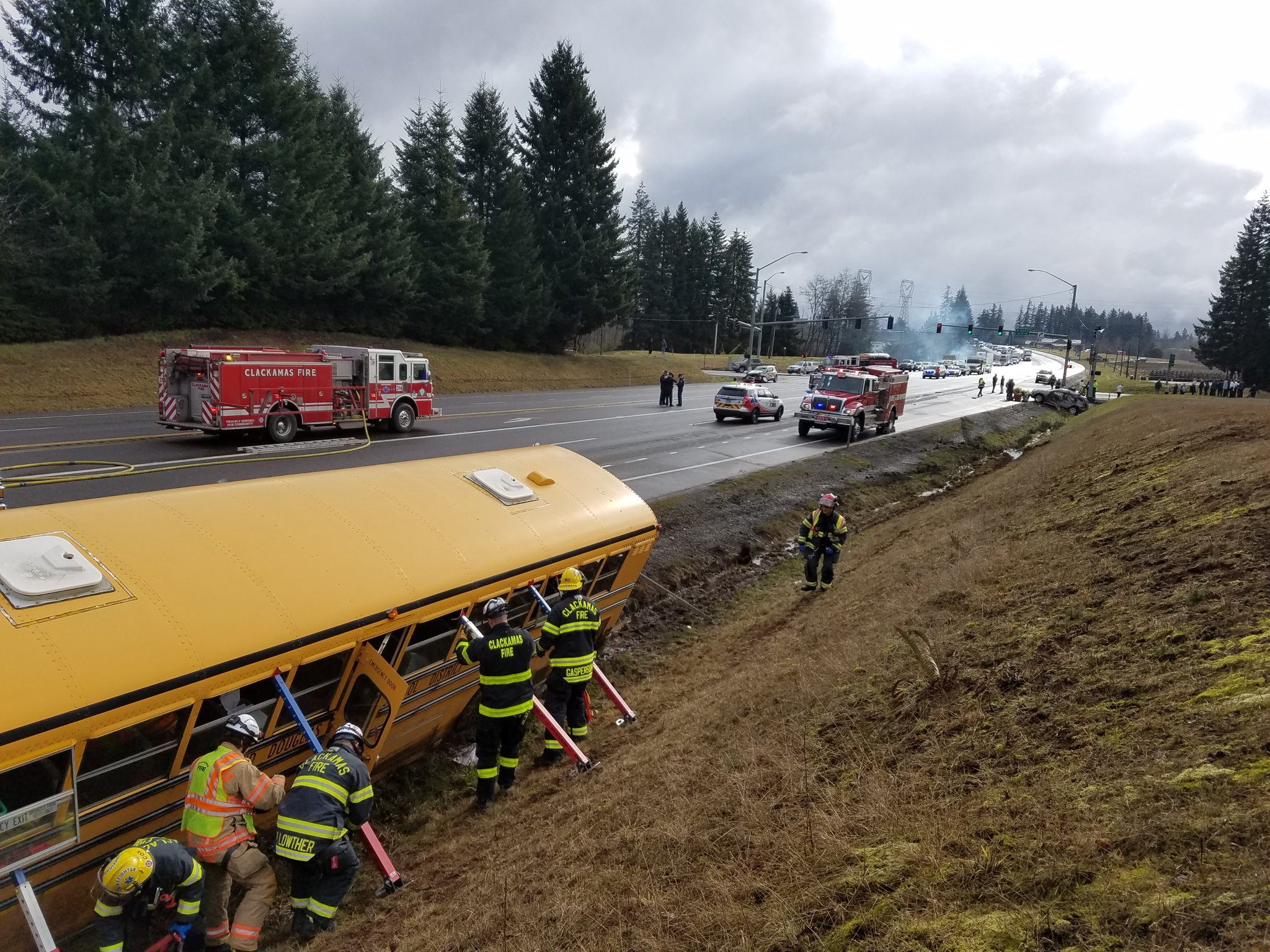 A school bus was involved in a multi-vehicle crash 2 miles west of Sandy on March 12, 2019. Clackamas Fire says several students, the bus driver, and others were taken to the hospital. Photo courtesy Oregon State Police{ }