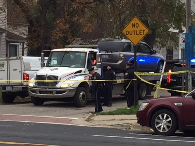 Police tow a car away from the Kalamazoo, Michigan, home where three people were shot early Thursday morning, Nov. 9, 2017. (WWMT/Jessica Wheeler)<p></p>