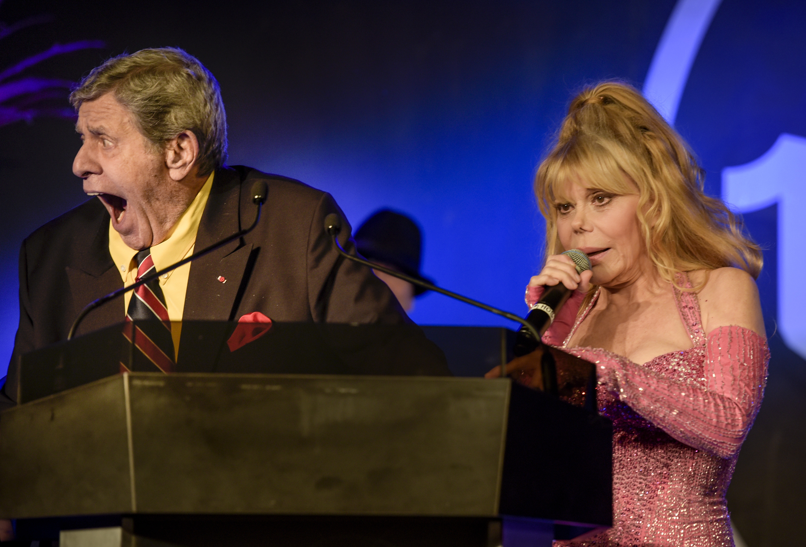 Casino Entertainment Legend Award winner Jerry Lewis, left, and Charo joke with the crowd at the 2015 Casino Entertainment Awards presented by the Global Gaming Expo at Vinyl in the Hard Rock Hotel & Casino in Las Vegas on Wednesday, Sept. 30, 2015. CREDIT: Mark Damon/Las Vegas News Bureau
