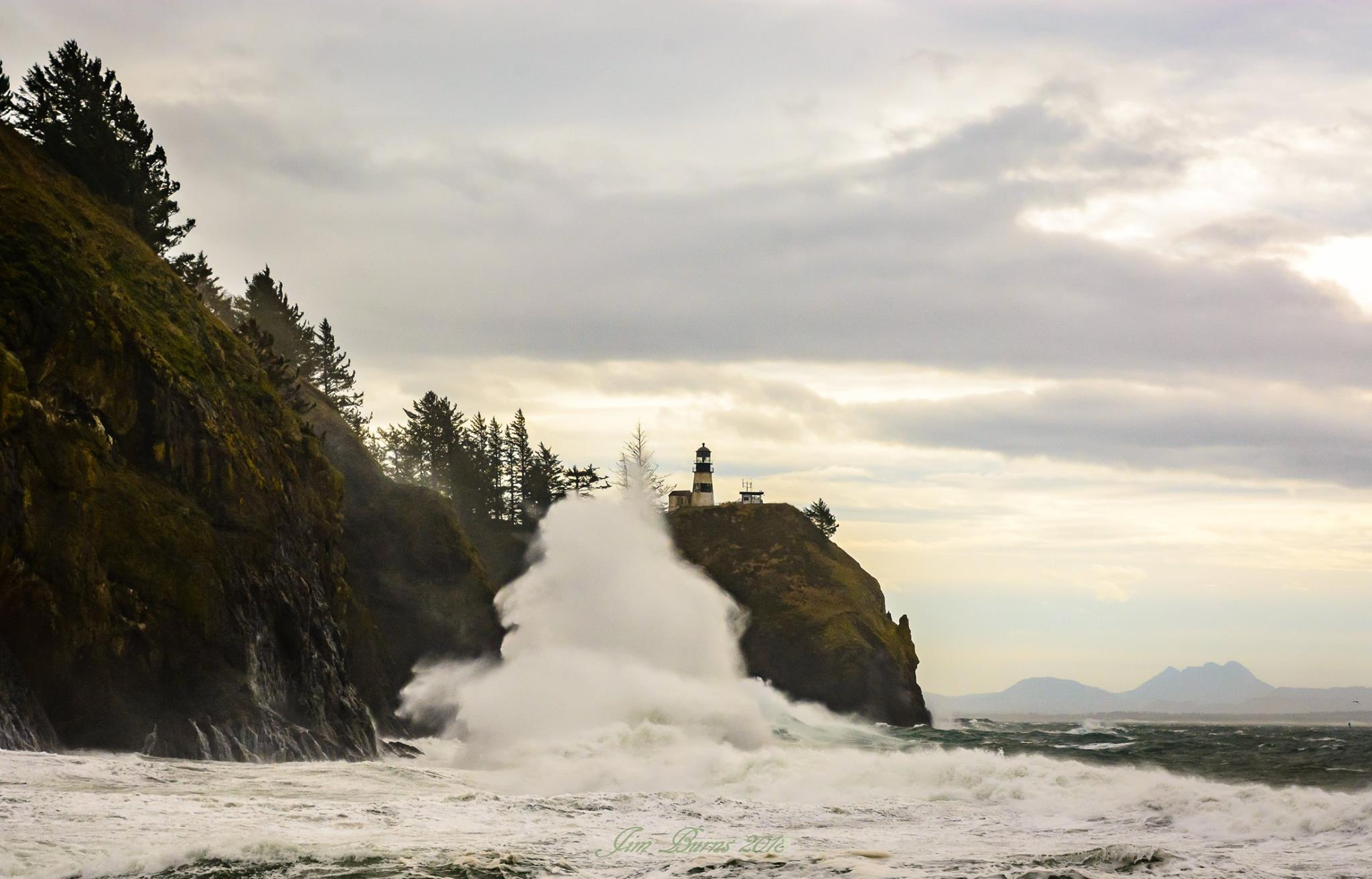 Large waves crash into the rocky shores of Cape Disappointment (Photo: Jim Burns)