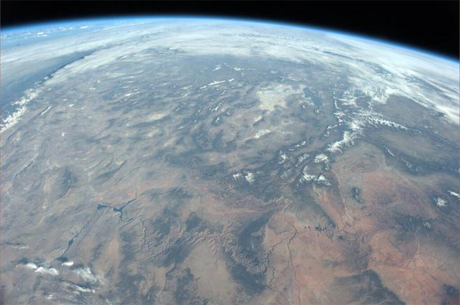 Flying over Grand Canyon (center low in the photo).   Spectacular view!  (Photo & Caption courtesy Koichi Wakata (@Astro_Wakata) and NASA)