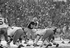 His face wreathed with steam from his breath, Packers quarterback Bart Starr calls signals in bitter cold during the NFL Championship Game, Dec. 31, 1967, at Lambeau Field. Starr tossed two touchdown passes and scored the winning touchdown himself with seconds to play in the game.