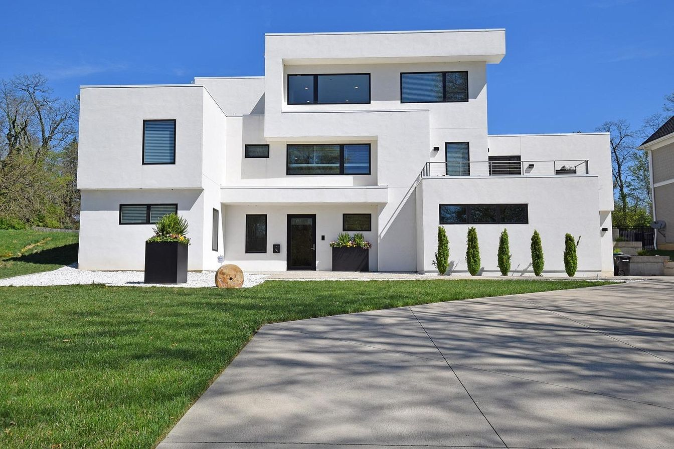 <p>3012 Erie Avenue in Hyde Park - $1,499,000 / Made with real stucco, this modern Hyde Park abode gleams brightly along Erie Avenue with its sharp edges and minimalist aesthetic. The four-bedroom, four-and-a-half-bathroom home is massive, too, measuring out to a whopping 5,264 square feet! It's LEED Platinum certified and tax abated until 2030 to boot. It sits on a half-acre of land. / Our favorite feature: It has a unique aesthetic for a home in Hyde Park, and we like a one-of-a-kind build. / Image: Comey & Shepard // Published: 1.9.20</p>