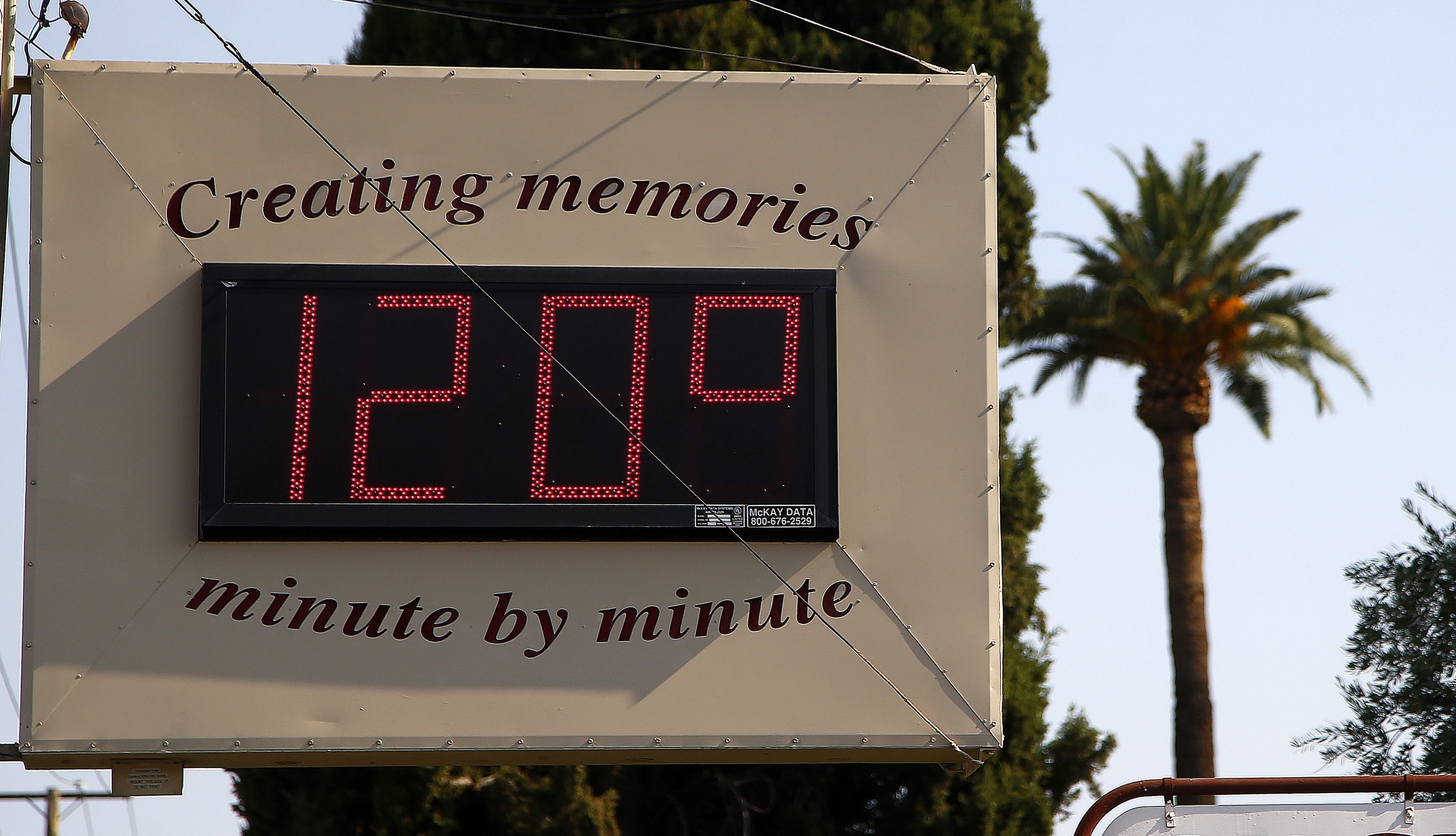 A local temperature sign reads 120-degrees as temperatures climb to near-record highs Tuesday, June 20, 2017, in Phoenix. The National Weather Service forecasts a high of 120 degrees (49 degrees Celsius), which is has only hit three times in recorded history in Phoenix, the last time 22 years ago. (AP Photo/Ross D. Franklin)