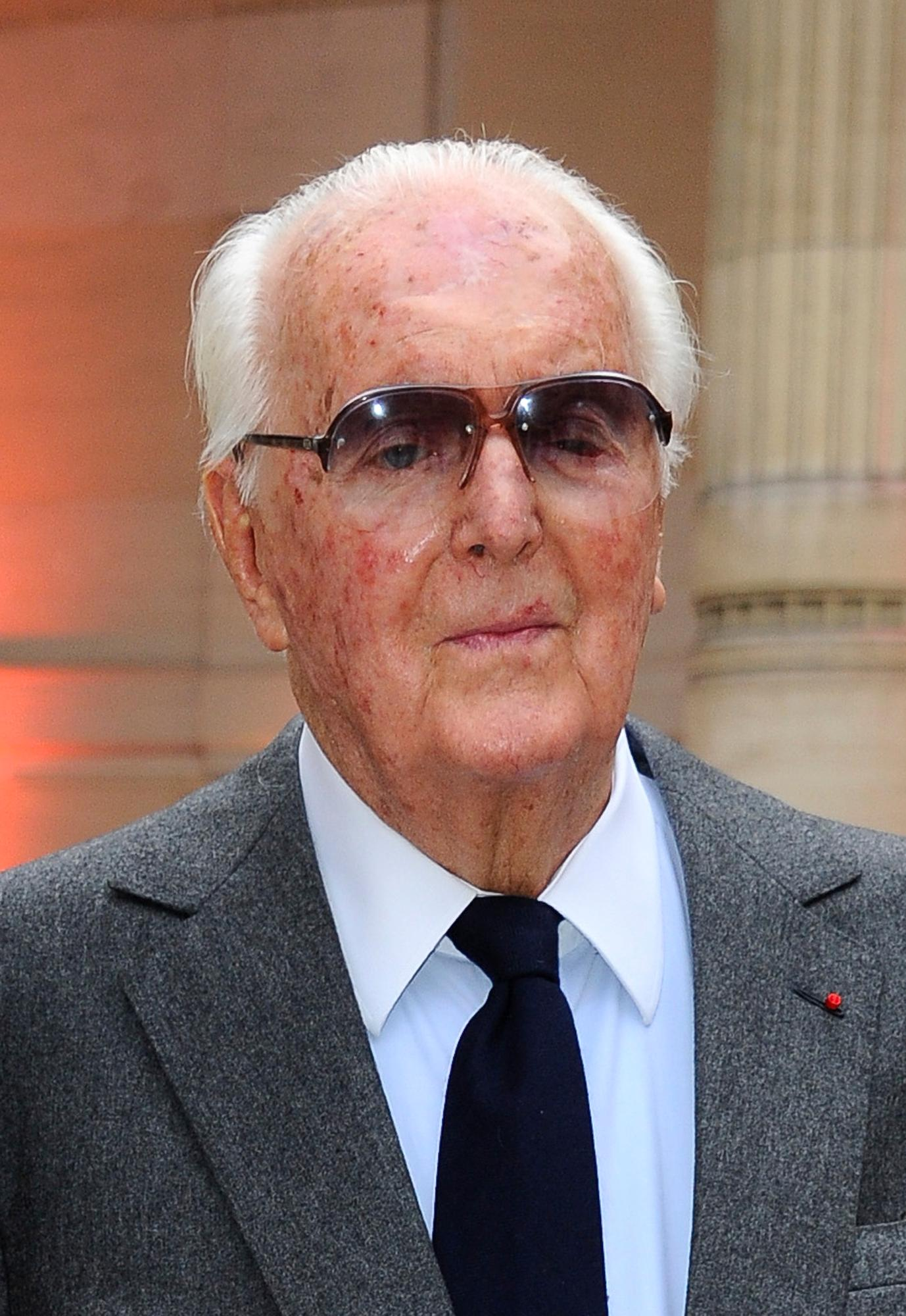 "FILE - In this Sept.25 2013 file photo, Hubert de Givenchy arrives at the Alaia exhibit Gala. in Paris. French couturier Hubert de Givenchy, a pioneer of ready-to-wear who designed Audrey Hepburn's little black dress in ""Breakfast at Tiffany's,"" has died at the age of 91. (AP Photo/Zacharie Scheurer, File)"