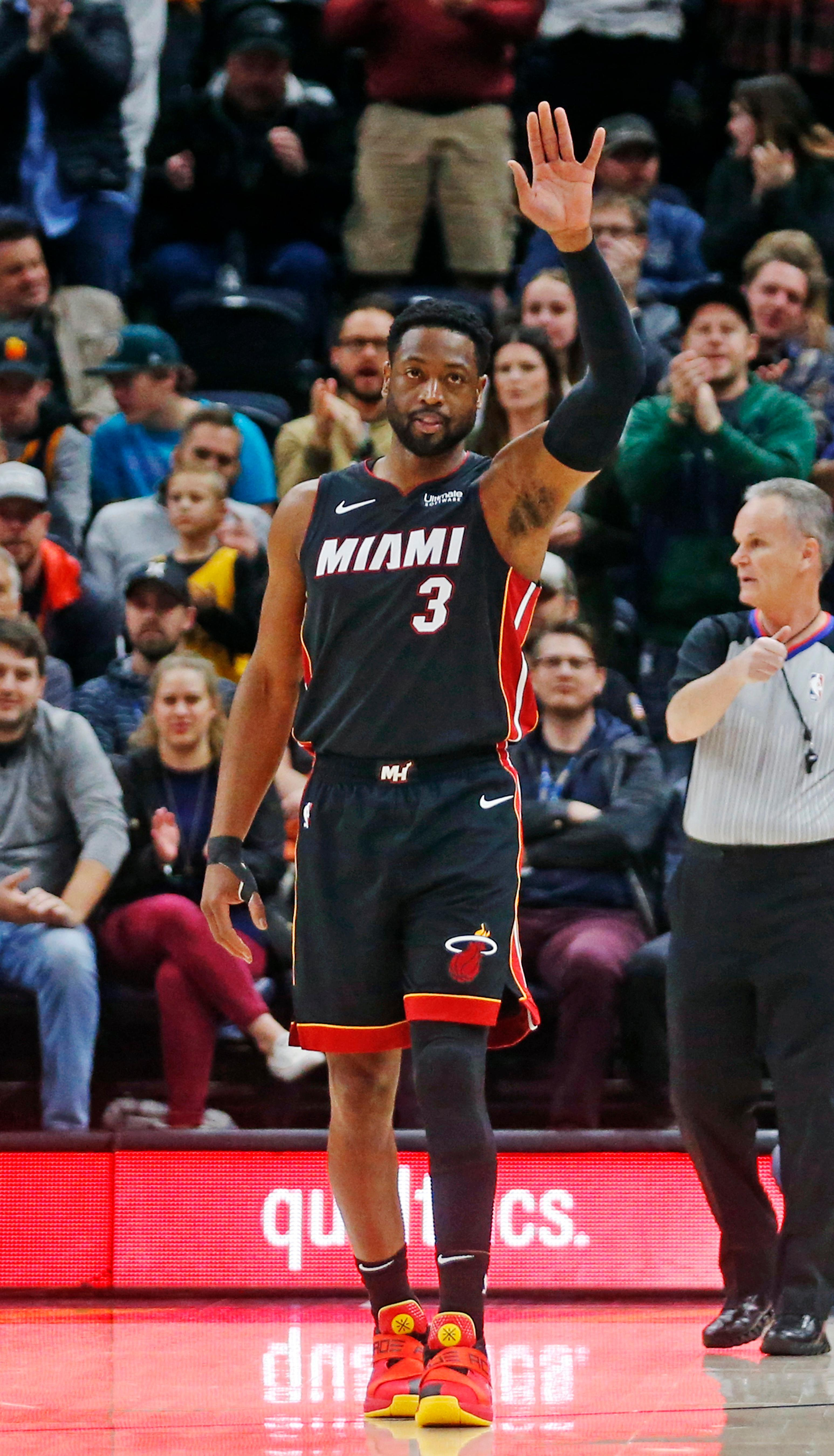 Miami Heat guard Dwyane Wade (3) waves to the fans as he is introduced in the first half of an NBA basketball game against the Utah Jazz, Wednesday Dec. 12, 2018, in Salt Lake City. (AP Photo/Rick Bowmer)
