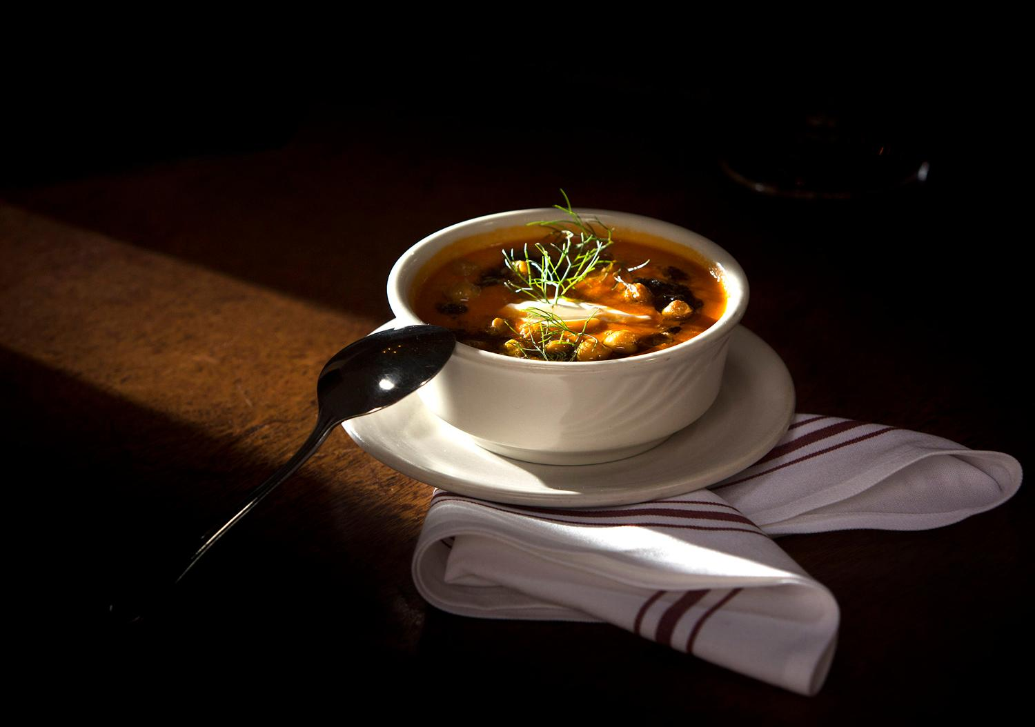 Agrodolce chef Abby Canfield cooks up up a Tomato and Fennel Soup, with oil cured olive tapenade, fried chickpeas, and whipped yogurt, for Seattle Restaurant Week. (Sy Bean / Seattle Refined)(Sy Bean / Seattle Refined)<p></p>