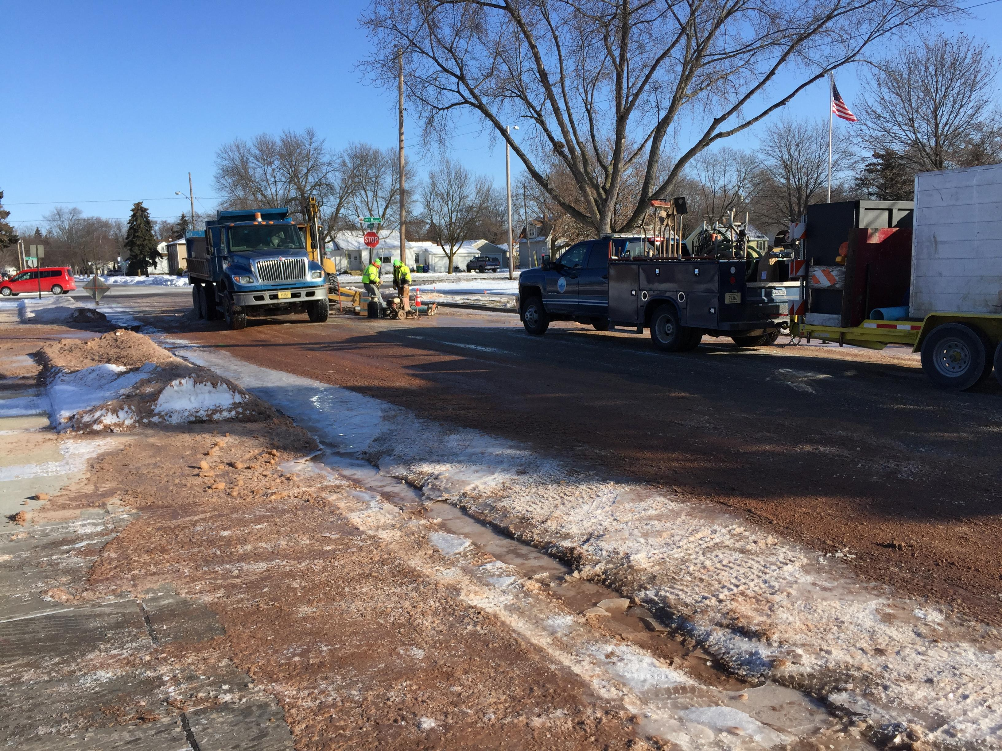 Water main break at West Mason Street and Heyrman Street in Green Bay, December 26, 2017 (WLUK/Eric Peterson)