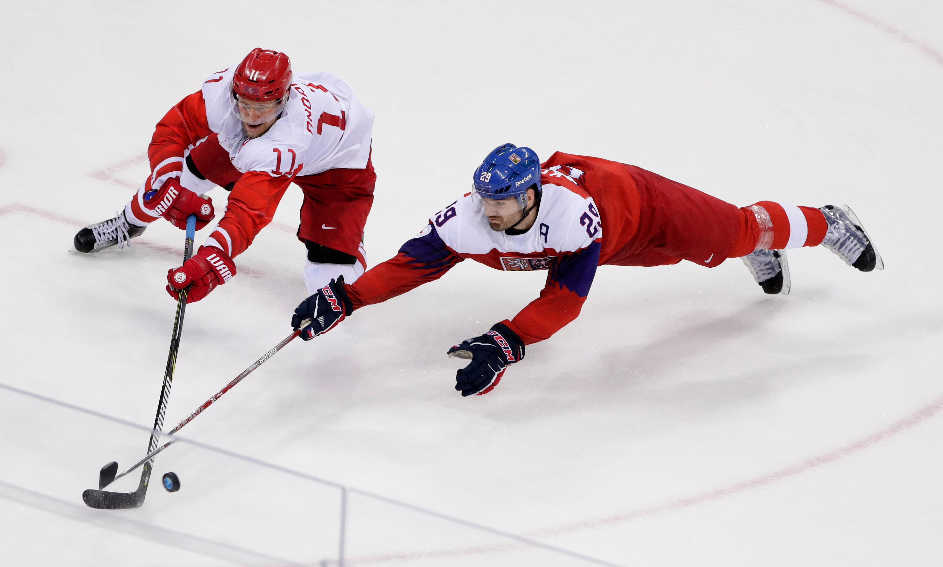 Russian athlete Sergei Andronov (11) and Jan Kolar (29), of the Czech Republic, battle for the puck during the third period of the semifinal round of the men's hockey game at the 2018 Winter Olympics in Gangneung, South Korea, Friday, Feb. 23, 2018. (AP Photo/Frank Franklin II)