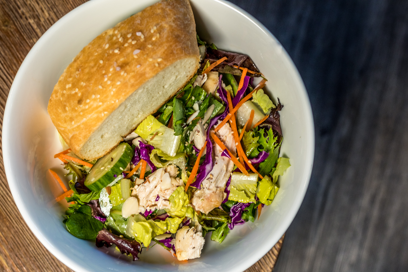 Vivian's Chinese Chicken Salad: roasted chicken, mixed greens, purple cabbage, cucumbers, carrots, edamame, and cilantro tossed in a sesame dressing and served with Pang Bread / Image: Catherine Viox // Published: 1.8.20