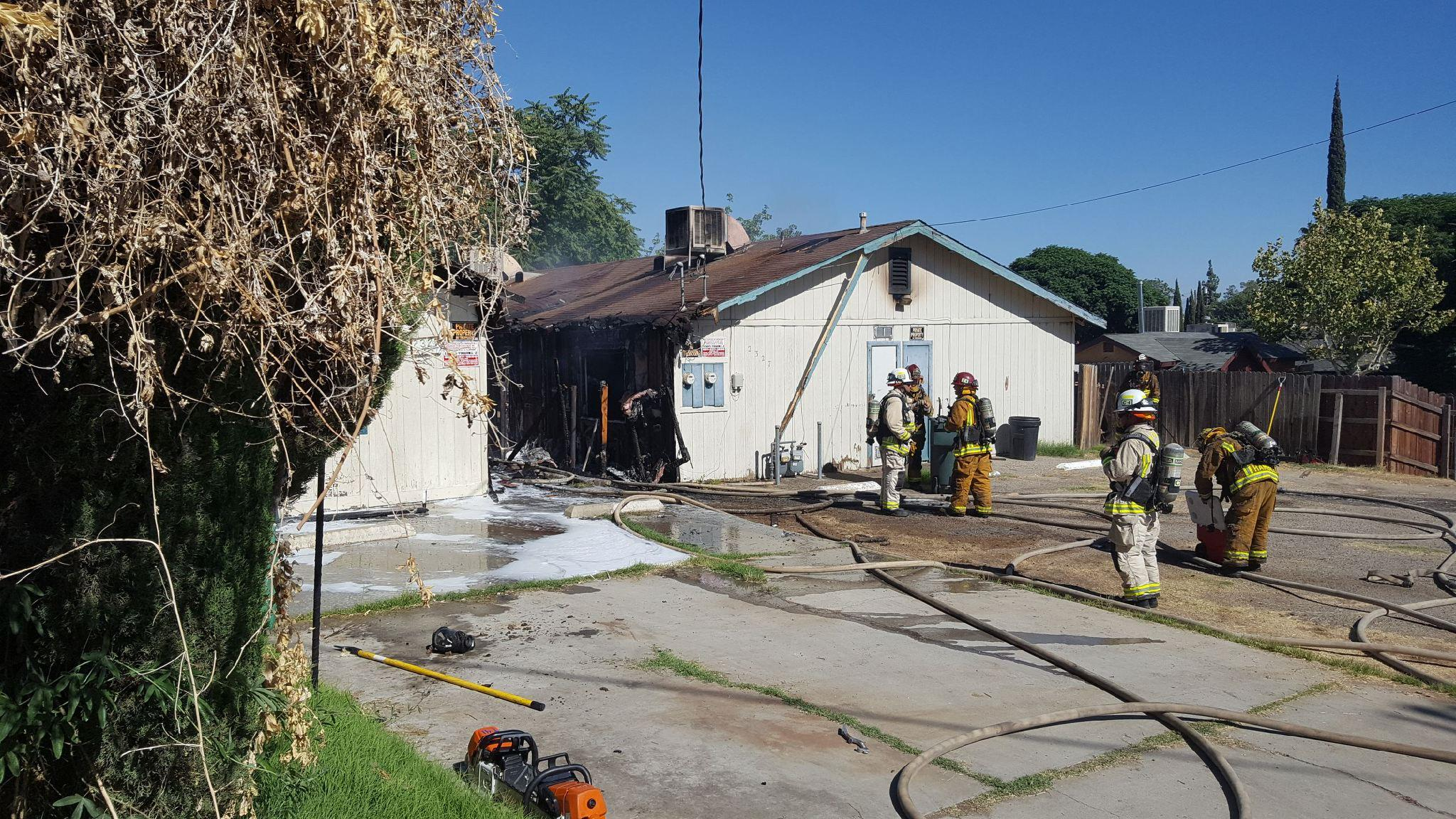 Firefighters are on scene of a residential fire off Wilshire Alley in Bakersfield, Calif., Thursday, June 29, 2017. Fire officials say one person died in the fire. (KBAK/KBFX photo/Octavio Flores)