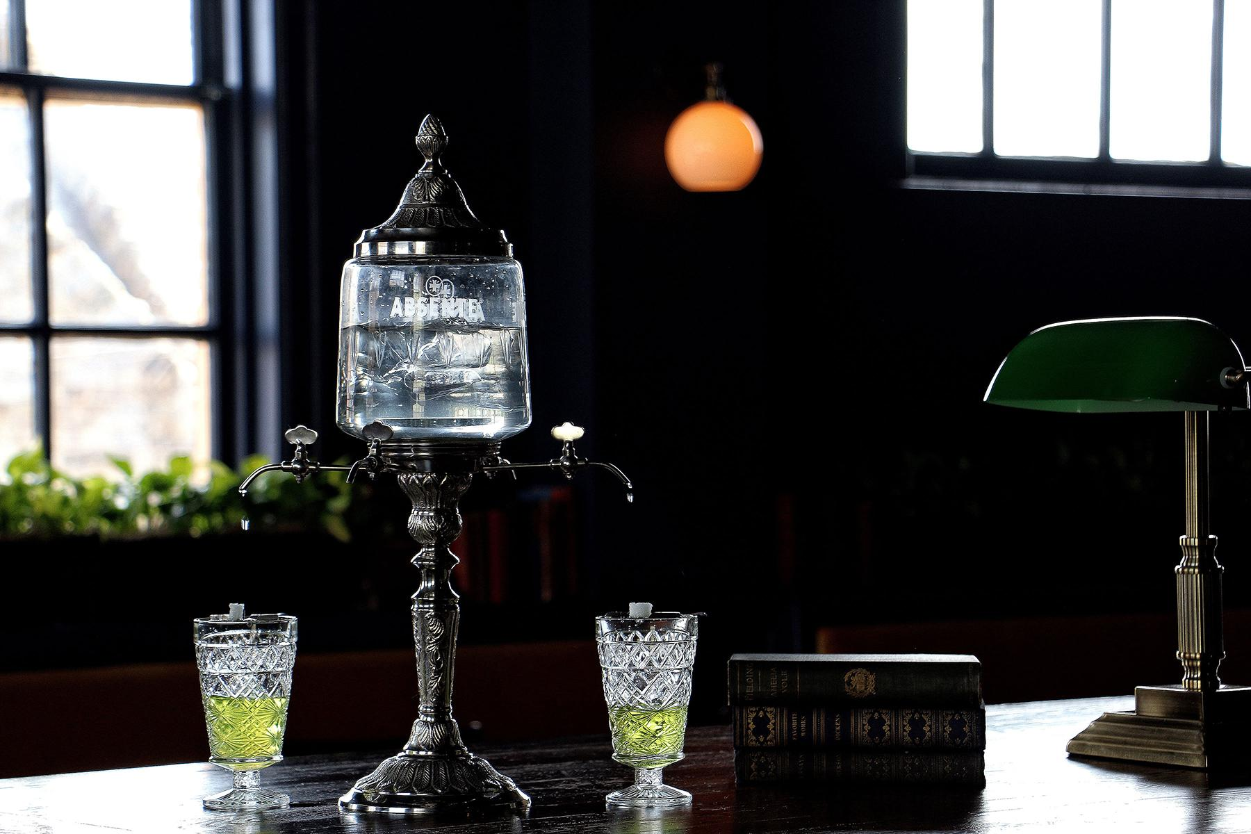 "Absinthe Drip: The classic presentation of the French liqueur. ""From her sacred groves, with maniac step the Pythian Laura moves, full on her lips, and fury in her eyes, strong writhe her limbs, and her wild dishevell'd hair, starts from her laurel wreath, and swims in air."" (Image: Jai Williams)"