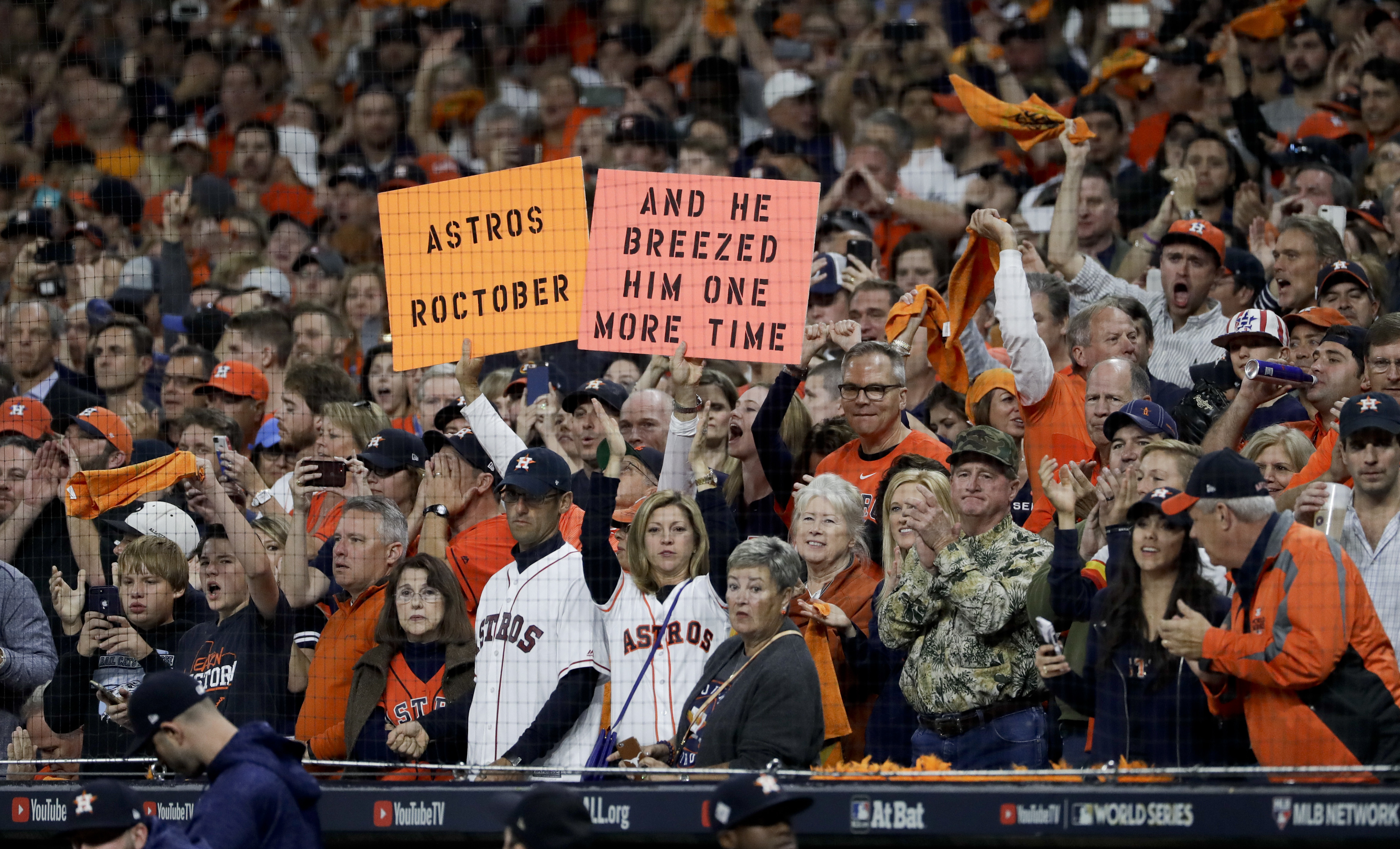 Houston Astros fans cheer during the ninth inning of Game 3 of baseball's World Series against the Los Angeles Dodgers Friday, Oct. 27, 2017, in Houston. (AP Photo/Matt Slocum)