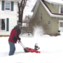 Neighbor clears snow for entire street's sidewalk