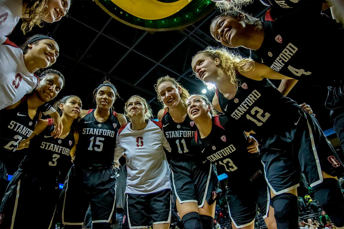 The Cardinal's celebrate their victory over the Ducks. The Stanford Cardinal defeated the Oregon Ducks 78-65 on Sunday afternoon at Matthew Knight Arena. Stanford is now 10-2 in conference play and with this loss the Ducks drop to 10-2. Leading the Stanford Cardinal was Brittany McPhee with 33 points, Alanna Smith with 14 points, and Kiana Williams with 14 points. For the Ducks Sabrina Ionescu led with 22 points, Ruthy Hebard added 16 points, and Satou Sabally put in 14 points. Photo by August Frank, Oregon News Lab