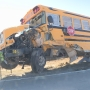 Truck collides with school bus, sending 3 to hospital