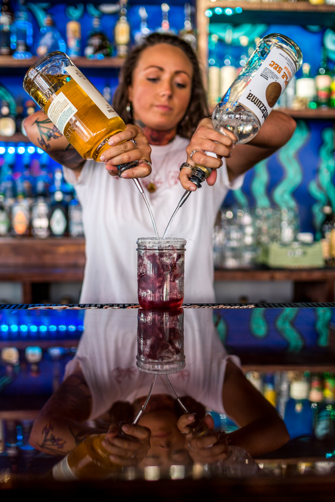 Lauren Avery pouring a blackberry margarita / Image: Catherine Viox{ }// Published: 6.9.19