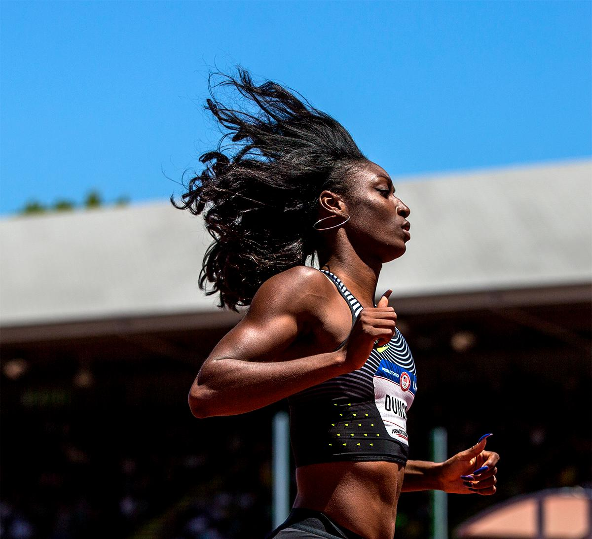 Nike's Kimberlyn Duncan's hair was flying high as she finished the 100 meters. Photo by August Frank, Oregon News Lab