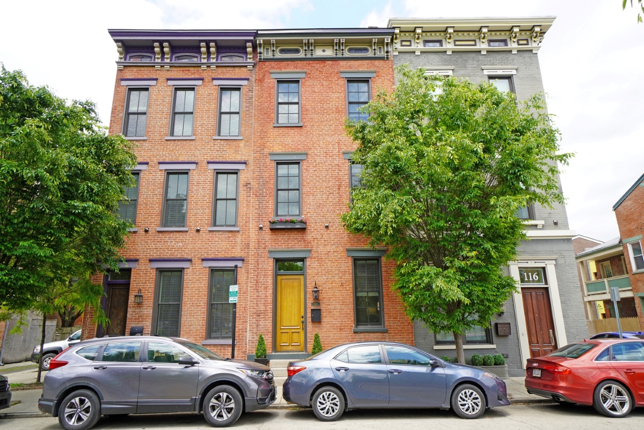 118 W. 14th Street (45202) is a stately brick rowhouse that features nearly 3,000 square feet of living space over four floors, in addition to a basement. Throughout the home, built in 1850, you'll find exposed brick, a mix of gorgeous hardwood floors, and plush new carpet. In the heart of Over-the-Rhine, it's mere steps away from Washington Park and Music Hall. It's currently on the market for  $899,900. / Image courtesy of Brian Hubert via Comey & Shepherd{ }Realtors  // Published: 6.9.20