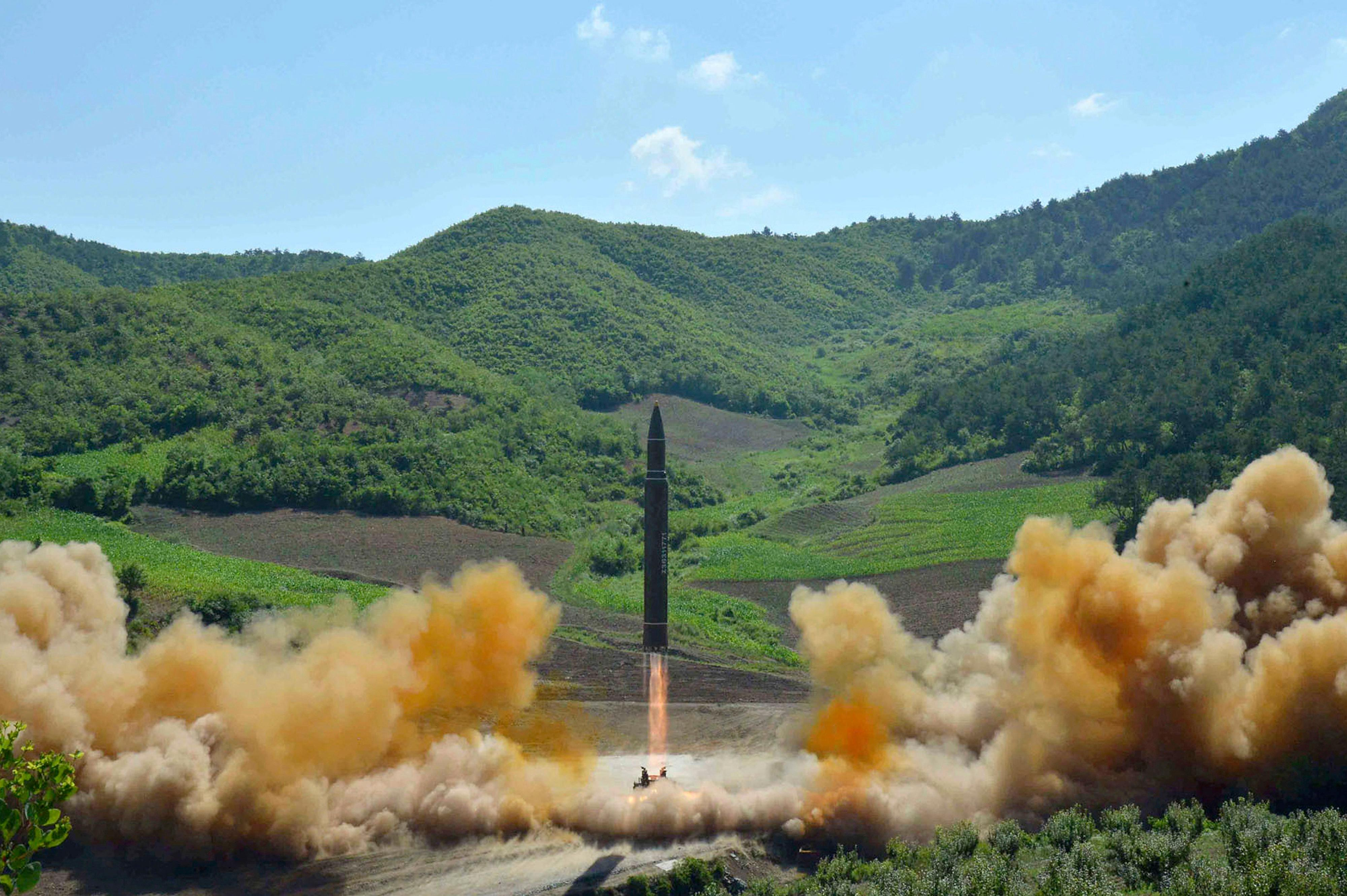 FILE- In this July 4, 2017, file photo distributed by the North Korean government shows what was said to be the launch of a Hwasong-14 intercontinental ballistic missile, ICBM, in North Korea's northwest. North Korea has been condemned and sanctioned for its nuclear ambitions, yet has still received food, fuel and other aid from its neighbors and adversaries for decades. How does the small, isolated country keep getting what it wants and needs to prevent its collapse? (Korean Central News Agency/Korea News Service via AP, File)