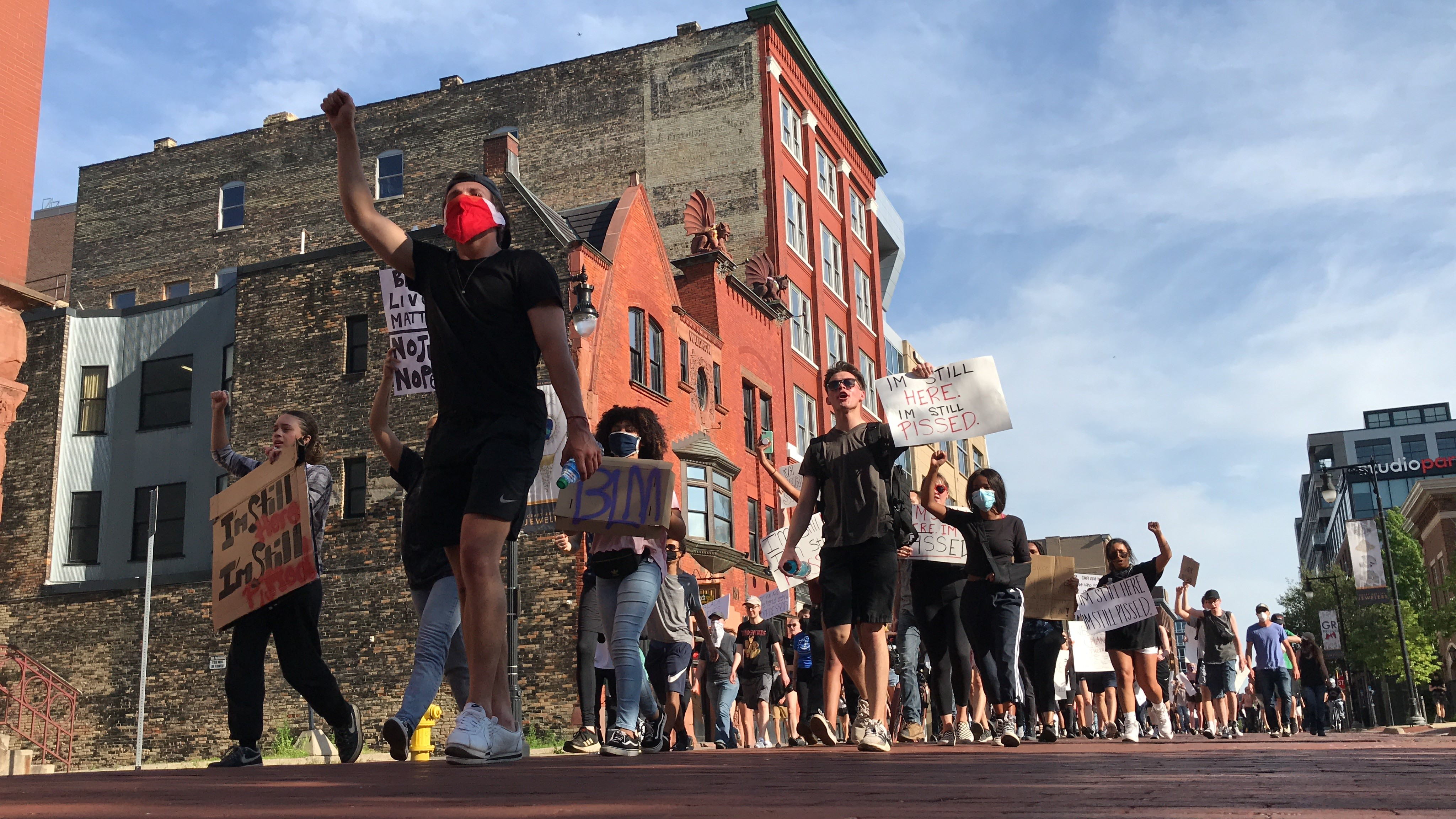Soon after the silent protest was over a second group of protesters marched around several blocks in downtown Grand Rapids with officers on bikes trailing behind.{ }(WWMT/Jason Heeres)