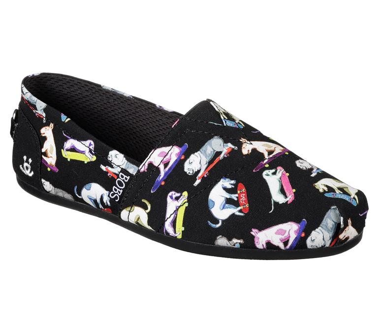 "You'll get puppy love for this skateboarding pooches print, available in black or white multi. These slip ons have the ""BOBS for Dog"" logo detail on the heel. Bow-wow! (Image: Courtesy Skechers)"