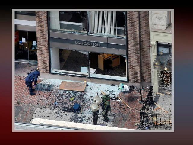 Bomb squad technicians investigate site of first explosion on Boylston Street near the finish line of the 2013 Boston Marathon.