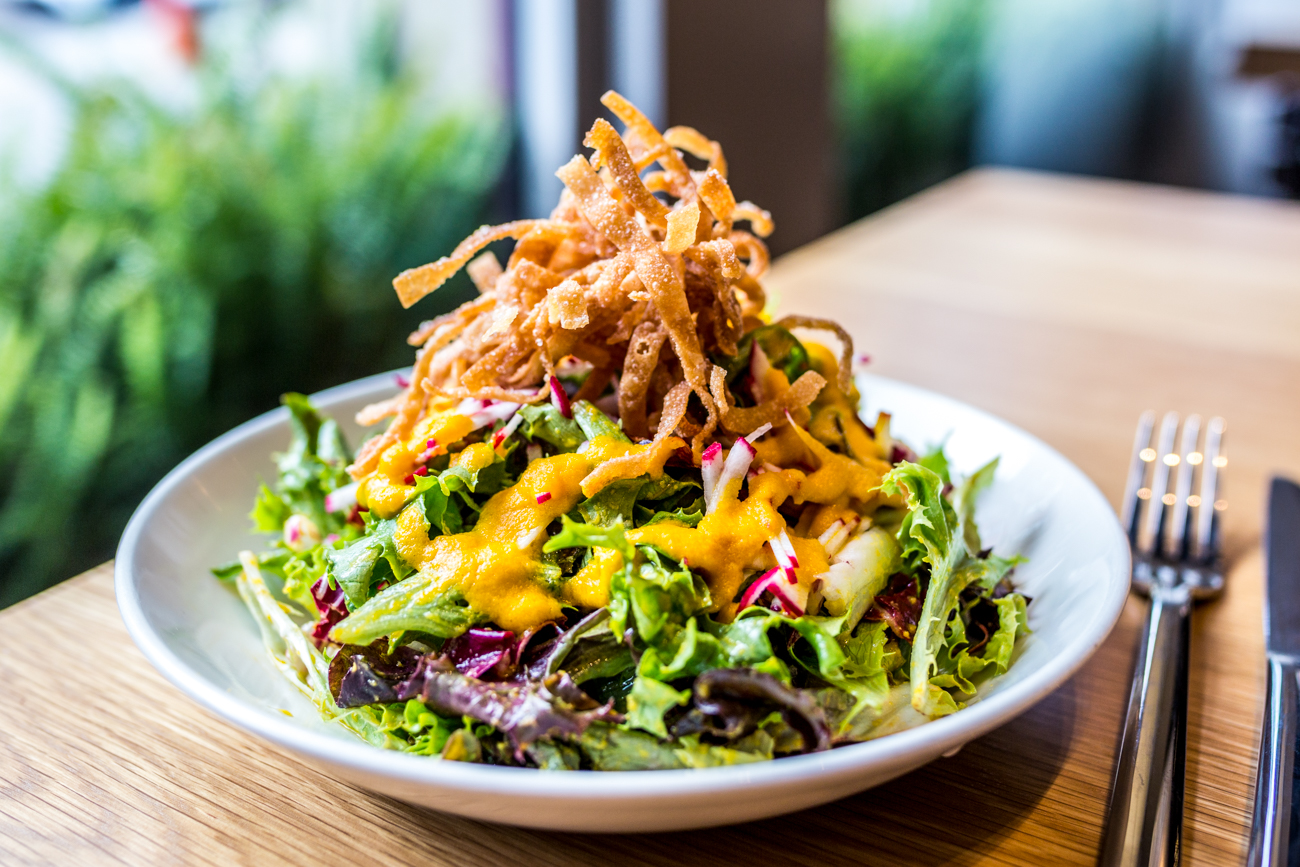Carrot Ginger Salad: mixed greens, radicchio, radish, crispy wonton, and carrot ginger dressing / Image: Catherine Viox // Published: 9.9.19