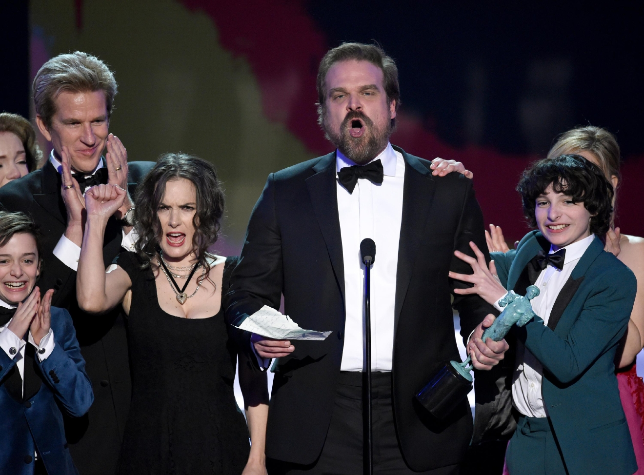 "David Harbour and the cast of ""Stranger Things"" accept the award for outstanding performance by an ensemble in a drama series at the 23rd annual Screen Actors Guild Awards at the Shrine Auditorium & Expo Hall on Sunday, Jan. 29, 2017, in Los Angeles. (Photo by Chris Pizzello/Invision/AP)"