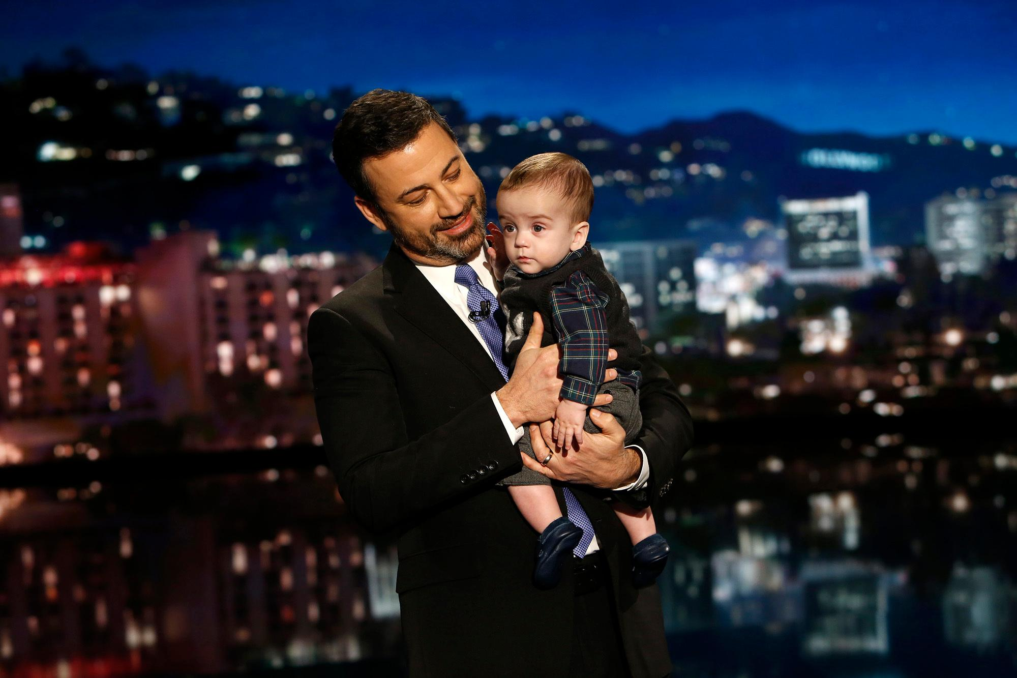 "This Dec. 11, 2017 image released by ABC shows host Jimmy Kimmel with his son Billy on ""Jimmy Kimmel Live!"" Kimmel held his baby son as he returned to his late-night show after a week off for the boy's heart surgery. Kimmel kept up his ardent advocacy Monday night, urging Congress to restore the Children's Health Insurance Program, which has been left unfunded and stuck in a political stalemate since September. (Randy Holmes/ABC via AP)"