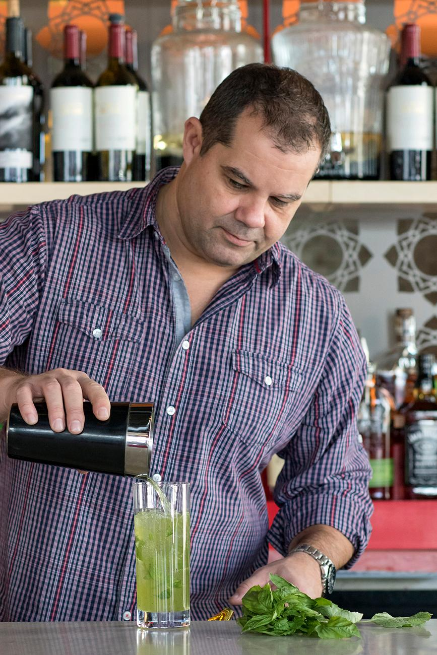Bryan Henderson, director of operations, making a Green Dragon, a Thai inspired mojito / Image: Allison McAdams // Published: 1.21.18<p></p>