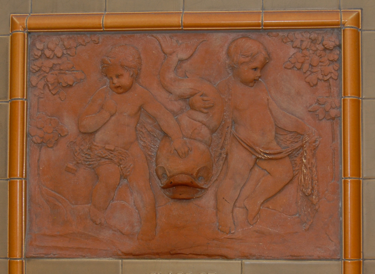 A fountain depicting two children wrangling a large fish was donated by the class of 1940. It is located on the third floor in the west (back) corridor. / Image and research by Tim Jeffries // Published: 4.28.19<p></p>