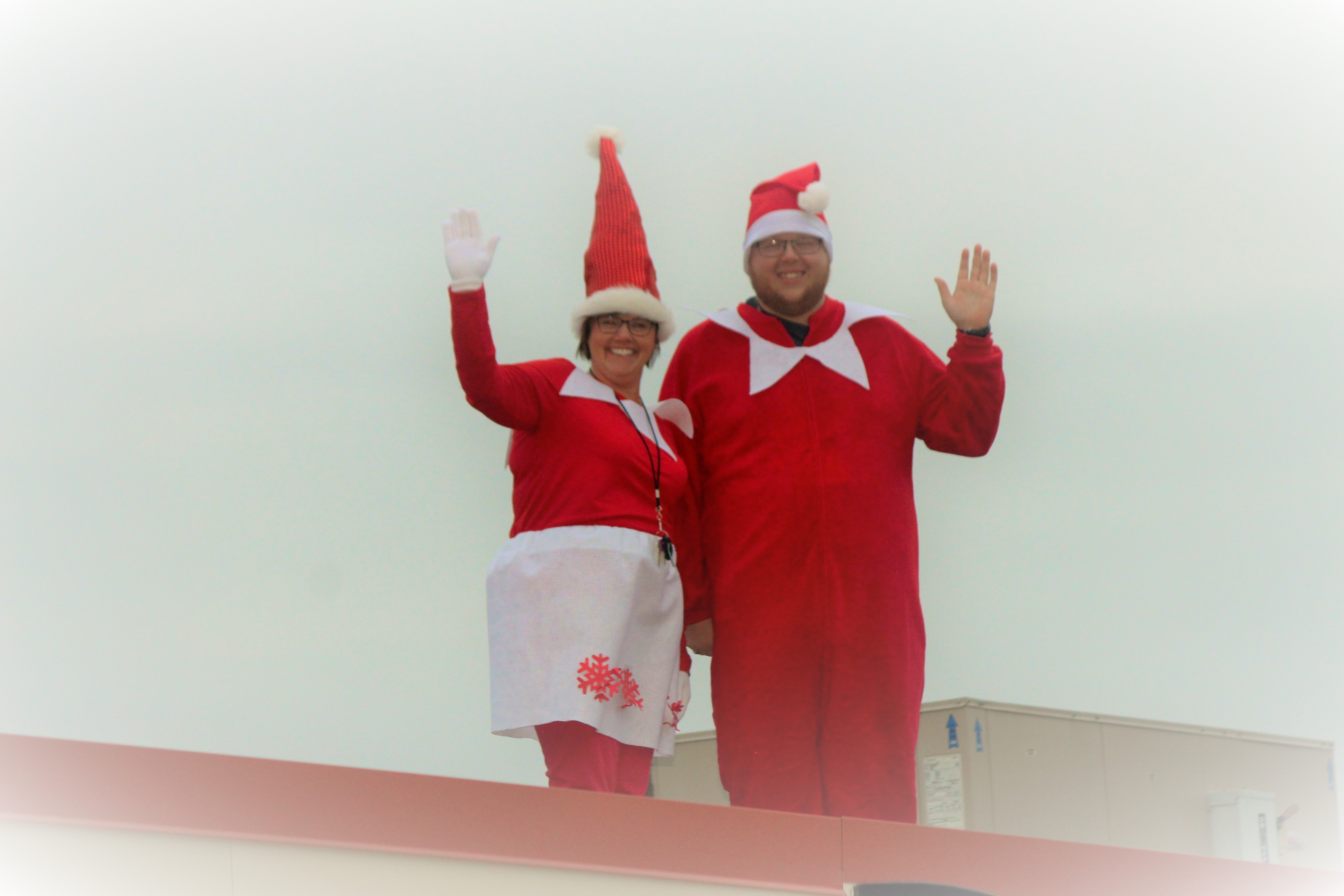 <p>New Bloomfield Elementary Principal Julie Gerloff, and P.E. teacher Nick Trammell, greeted students from the rooftop dressed as elves Friday. (Photo courtesy of Julie Gerloff)<br></p>