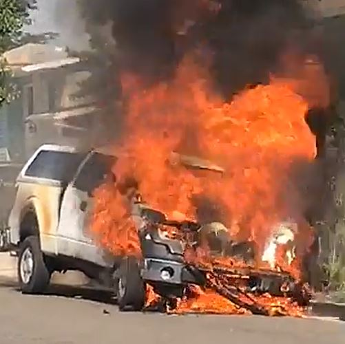 Police confirmed a woman was shot and killed where a city truck and a house were set on fire Thursday. (Photo: KUTV)