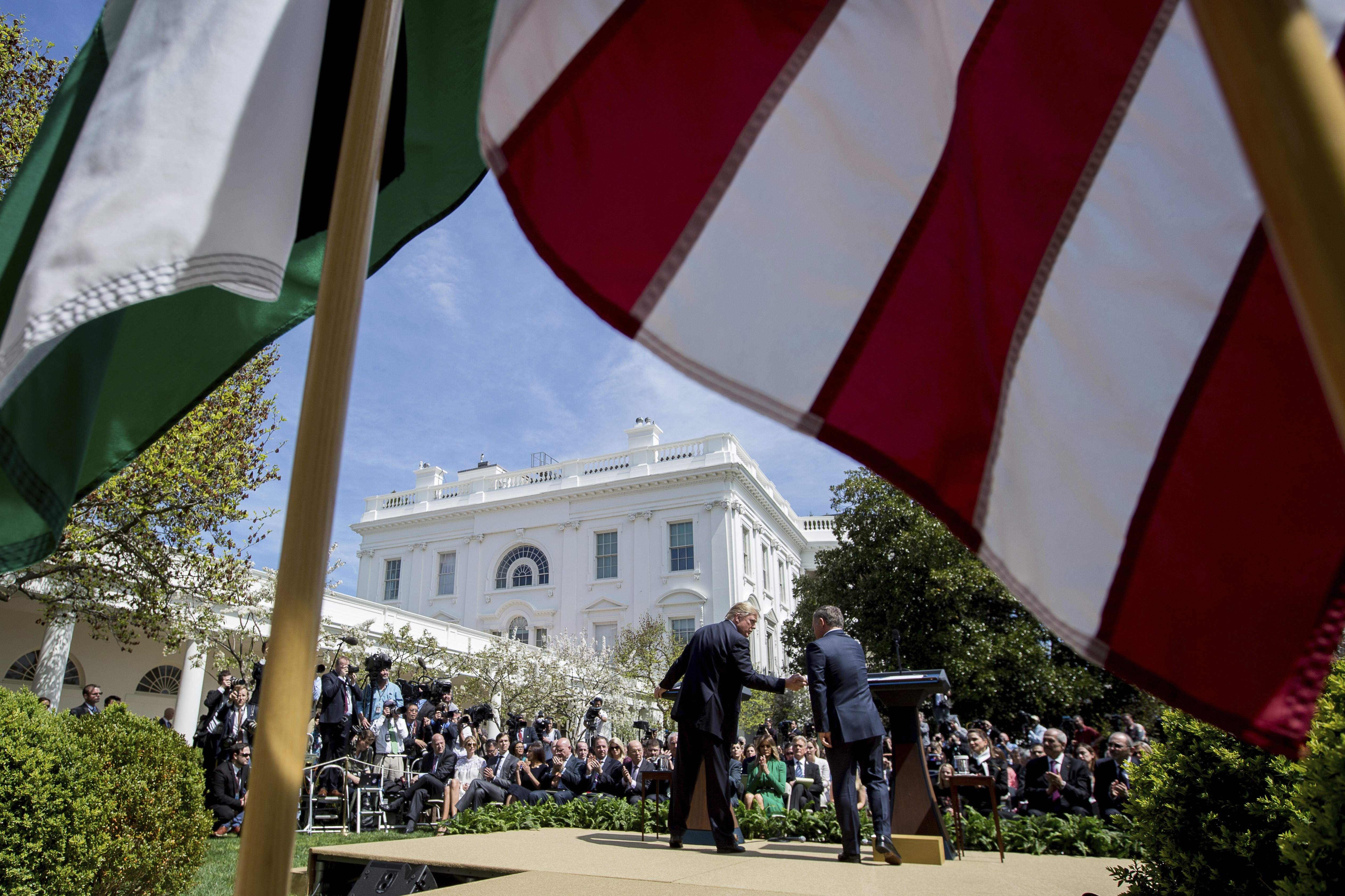 DAY 76 - in this April 5, 2017, file photo, President Donald Trump and Jordan's King Abdullah II shake hands during their news conference in the Rose Garden of the White House in Washington. (AP Photo/Andrew Harnik, File)